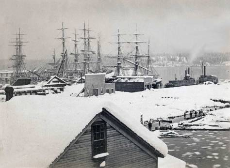 1880 wet snow damage on Yesler's Wharf as recorded from the rear of the Peterson & Bros studio at the foot of Cherry Street . (Courtesy Greg Lang)