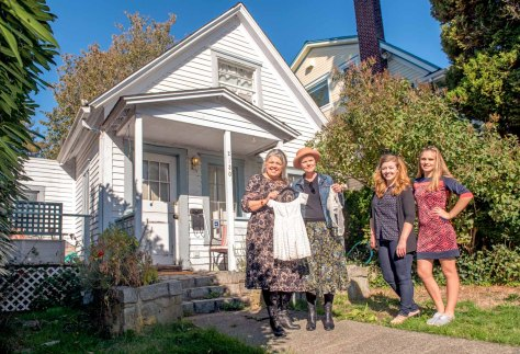 "NOW: Left to right, Susan Fleming, Carol Solle, and Fleming's two daughters, Annika and Kristina, pose for Jean Sherrard in front of the same home at 2130 N. 62nd Street. The healthy bush on the left made it impossible for Jean Sherrard to reach the prospect of the ""then."""