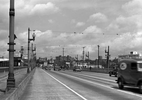 Like the featured photo at the top, this is another from the collection of negatives covering the properties of the Foster-Kleiser Billboard company. This one is recorded with the photographer's back to the bascule center of the University Bridge. The negative is dated June 10, 1940. .