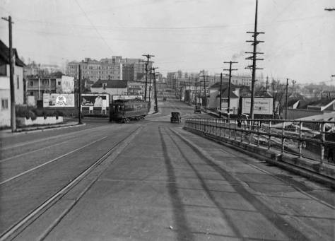 This 1929 look east thru the same block may be compared to the 1940 shot at the top. For one difference, there's no Evidence of the future Applied Physics Laboratory on the far right. Another difference is found with the billboards. There are more of them in 1929. Also, in '29 the trolleys and motorcars were still using the old 1919 University Bridge with the timber approaches to its bascule center, but all that is behind the unnamed photographer. (Courtesy, again, Ron Edge.)