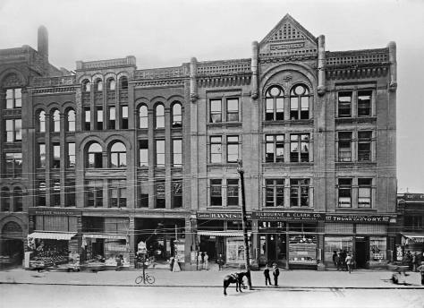 THEN: The west side of Second Avenue between Columbia and Marion Streets was typical of the commercial district that was quick to develop after the city's Great Fire of 1889. (Courtesy, Museum of History and Industry)