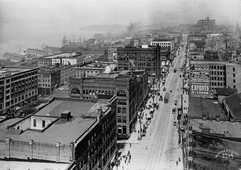 """Our block,"" fills the center of this look north from the roof or upper floor of the then new Alaska Building - Seattle's first scraper - at the southeast corner of Cherry and Second Avenue."