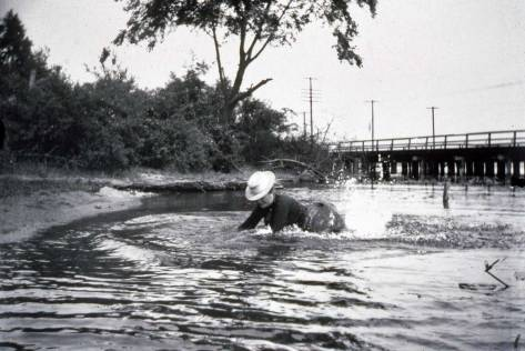 Circa 1903, Mother Brown playing in the lake at its southwest corner of with the Westlake Trestle nearly reaching the shore.