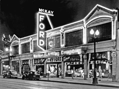 THEN: William O. McKay opened show rooms on Westlake in July of 1923. After fifty-seven years of selling Fords, the dealership turned to the cheaper and more efficient Subaru. Now reconstructed, the old Ford showroom awaits a new tenant.