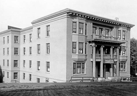 THEN: Built quickly in the winter of 1906-07, the Prince Rupert Hotel faced Boren Avenue from the third lot north of Pike Street. About fifty-five years later it was razed for the I-5 Freeway. (Courtesy Lawton Gowey)