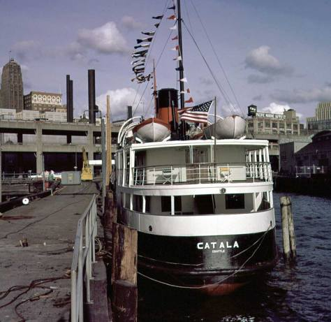 "The Century 21 ""boatel"" Catala parked at the south ""prong"" of what remained of the Schwabacher Dock in 1962."