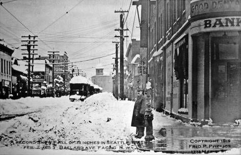 Peterson's other recording of the Big Snow looks back (northwest) over the same part of Ballard Avenue covered in the shot that is at the top. Here you can also see the tower of the Ballard City Hall and fire station..