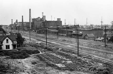 Seattle Brewing and Malting Georgetown plant seen looking southwest over main line railroad tracks.