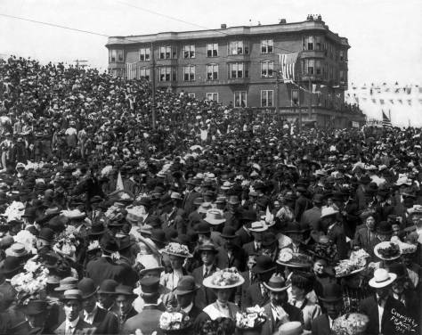 THEN: About a year after he recorded this fashionable throng on Second Avenue celebrating the visit of President Theodore Roosevelt's Great White Fleet in the spring of 1908, Frank Nowell became the official photographer for Seattle's six-month-long Alaska Yukon and Pacific Exhibition in 1909.