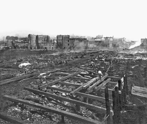 The first Yesler Wharf was built on pilings punched into and through fill. The subject looks east from the water end of Yesler Wharf following the 1889 fire that razed about 32 city blocks (depending upon how you define and count blocks.)