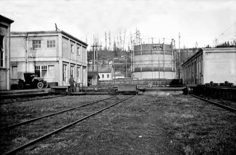 The tank is seen here looking east from the part of the company's trolley yards in Georgetown. This prospect is now part of Boeing Field.
