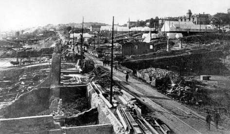 The 1889 ruins on Front Street (First Ave.) looking north from near where the Peterson and Bros Studio was a tenant in the late 1870s and early 80's. Compare this to the Elephant Store - Denny Hill shot above.