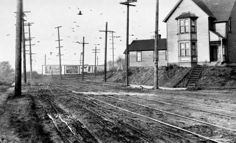 Here it is! Our intersection in the foreground where Western meets Denny Way, on the right, and extends it north to First Avenue West, at the curve. This too is possibly an earlier Lee recording. [Bless Lee and Gowey and the Seattle Municipal Archive.)