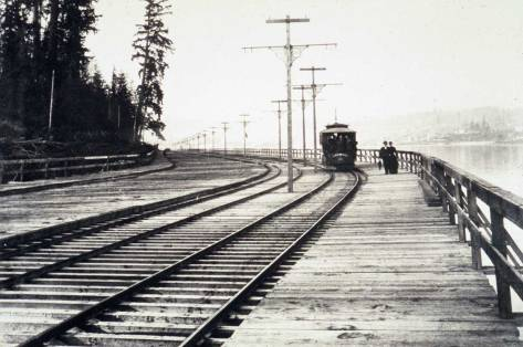 Looking north on Westlake by the lake in the 1890s. The viaduct continued along the west shore of Lake Union to the Fremont Bridge at Lake Union's Ross Creek outlet.