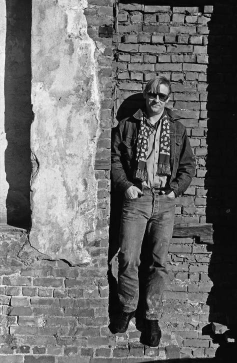 BEFORE THE GUM - Bill Burden posing in Post Alley long ago and before the gum. Bill took the photo of John T. near the top.