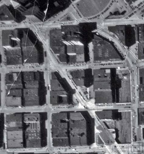 A detail from the citiy's 1936 mapping aerial. The completed Second Ave extension leaves several sliced structures including the Chin Gee Hee Building. Can you find it?