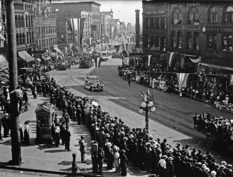Looking south on Second Ave. S. during an early Potlatch Parade. Note the Phoenix Hotel upper-left.