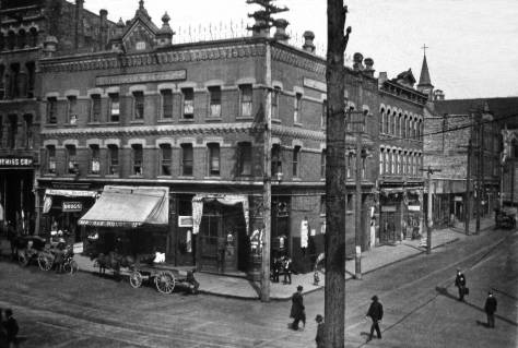 THEN: The Phoenix Hotel on Second Avenue, for the most part to the left of the darker power pole, and the Chin Gee Hee Building, behind it and facing Washington Street to the right, were both built quickly after Seattle's Great Fire of June 6, 1889. (Courtesy: Museum of History and Industry.)